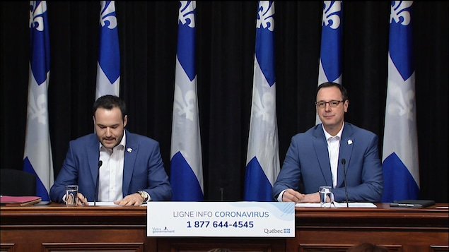 Mathieu Lacombe et Jean-François Roberge lors d'un point de presse.