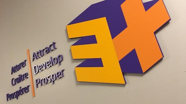 Le logo de l'organisme accompagné des mots : attirer, croître et prospérer.