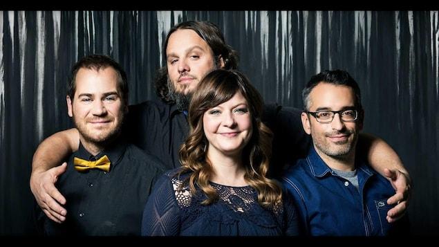 Une photo du groupe de musique Les Cowboys Fringants.