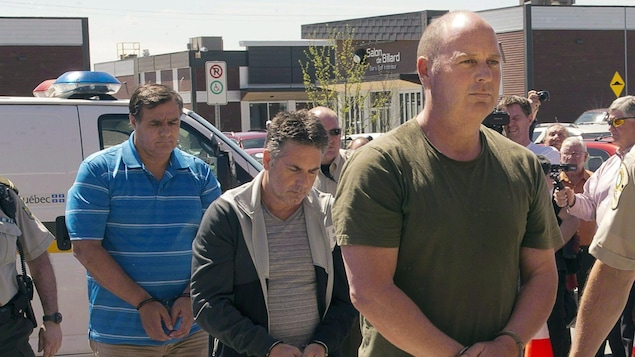 Tom Harding, Jean Demaitre, Richard Labrie au moment de leur arrestation.