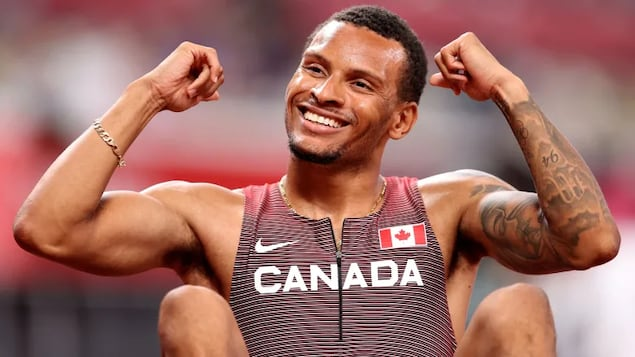 Canada's Andre De Grasse reacts after finishing first in a men's 200-metre semifinal heat on Tuesday in Tokyo. De Grasse posted a new Canadian record and personal best time of 19.73 seconds.