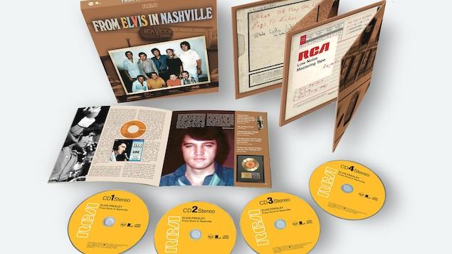 Photo représentant quatre disques et un coffret.