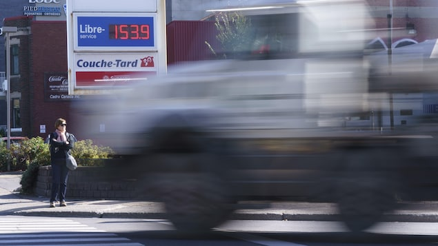 A truck drives by a gas station in Montreal on Wednesday, October 20, 2021. THE CANADIAN PRESS/Paul Chiasson