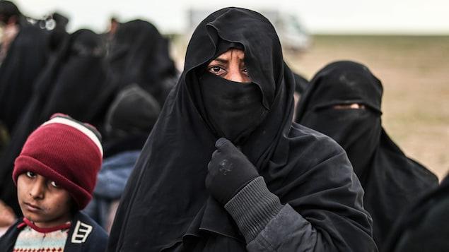 Des civils sont évacués à Baghouz, en Syrie, le 27 février.