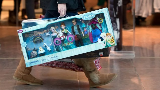 Disney announced in March that it planned to close 60 locations across North America this year, but had no specific comment on its Canadian locations. Now it appears as though all Canadian locations will be closed by next month. In this picture, a shopper carries Disney's Frozen dolls sets as she walks through the Trafford Centre shopping mall past retailers offering Black Friday discounts in Manchester, northern England on Nov. 27, 2015.