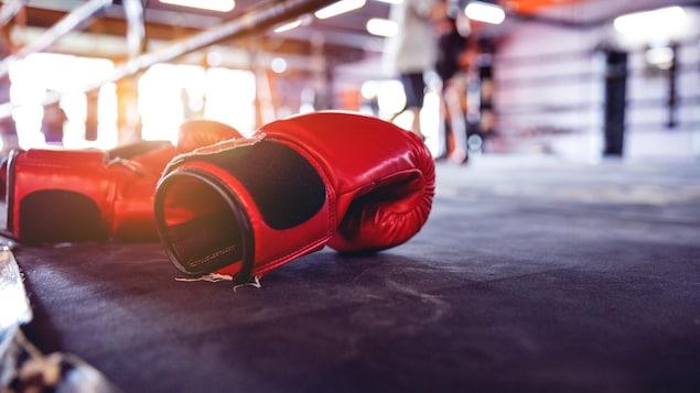 Modern gym facility in Bangkok, boxing gloves close up.