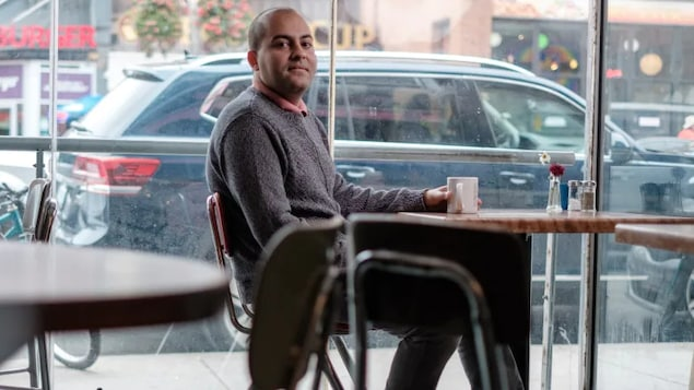 Gay man in Coffe shop. Federal judge reje.cts Health Canada's argument it has no role in ban barring gay men from donating blood.