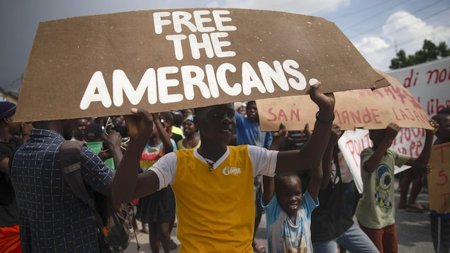 People protest for the release of kidnapped missionaries in Titanyen, north of Port-au-Prince, Haiti, on Tuesday.