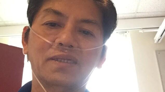 Hien Thach sous assistance respiratoire à l'hôpital.