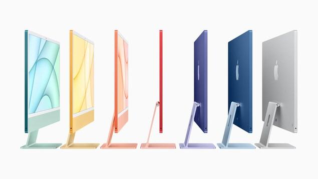 Une rangée de 7 ordinateurs arborant des couleurs différentes sur un fond blanc.