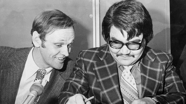 Indian Affairs Minister Jean Chretien jokes as Billy Diamond, chief of the Cree grand council signs an agreement in principal in Montreal for the continuing construction of the James Bay power project. Nov 14, 1974. (CP PHOTO/MG)