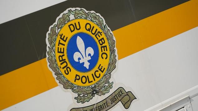 logo Sûreté du Québec SQ sur autobus