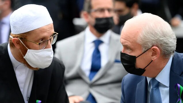 Conservative Leader Erin O'Toole, right, speaks with London Muslim Mosque imam Abd Alfatah Twakkal at a vigil for the victims of the deadly vehicle attack on five members of the Canadian Muslim community in London, Ont., on Tuesday, June 8, 2021. The party has little diverse representation in its Commons caucus after Monday's vote.