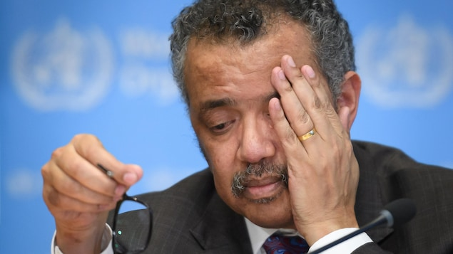 """World Health Organization (WHO) Director-General Tedros Adhanom Ghebreyesus attends a daily press briefing on COVID-19, the novel coronavirus, at the WHO headquaters on February 28, 2020, in Geneva. - The UN health agency on February 28, 2020, upgraded the global risk from the new coronavirus to its highest level, saying the continued increase in cases and countries affected was """"clearly of concern"""". The number of new coronavirus cases in the world rose to 83,853, including 2,873 deaths, across"""