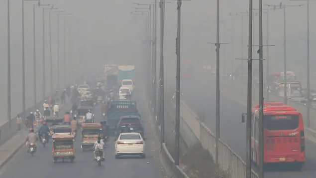 Vehicles drive on a highway as smog envelops the area of Lahore, Pakistan, on Nov. 11, 2020. The World Health Organization has reduced the recommended limits for six harmful air pollutants for the first time in 15 years.