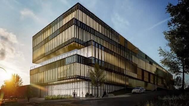 Maquette montrant un bâtiment de style contemporain de plusieurs étages. Il est entièrement vitré.