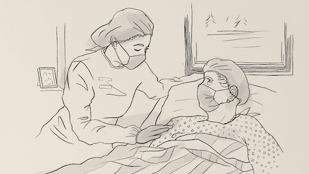Une femme portant un masque de protection réconforte un patient portant lui aussi un masque de protection, couché dans son lit