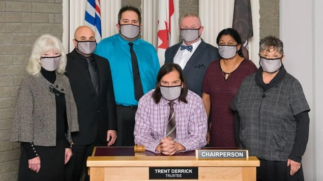 Prince George School District 57 Board Chair Trent Derrick, seated, and Vice-Chair Shuirose Valimohamed, second from right, have resigned citing systemic racism identified in a provincial Special Advisors Report released in late August 2021.