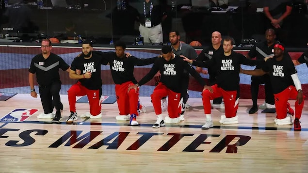 Raptors players take a knee on  before one of their games.