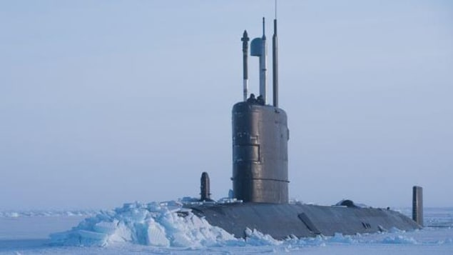 Royal Navy submarine breaking through metre-thick ice on the Arctic Ocean.