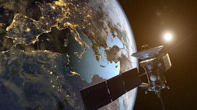 On voit un satellite et la Terre.