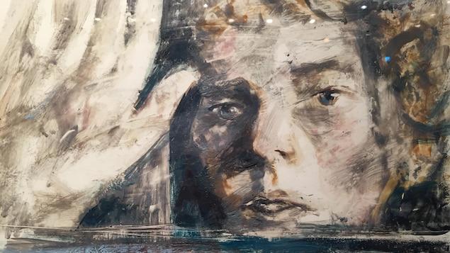 Une peinture du visage d'un homme