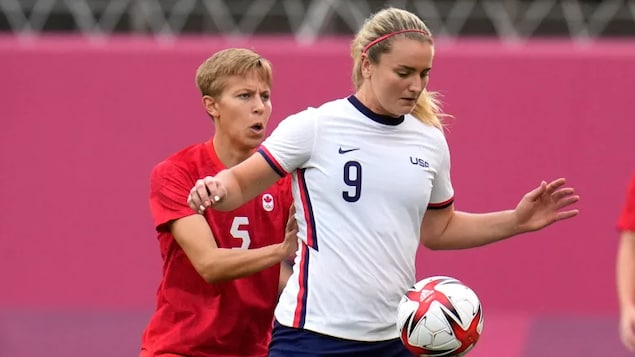 Canada's Quinn, left, and Lindsey Horan of the United States battle for the ball during their semifinal soccer match at Tokyo 2020 at Kashima Stadium on Monday.