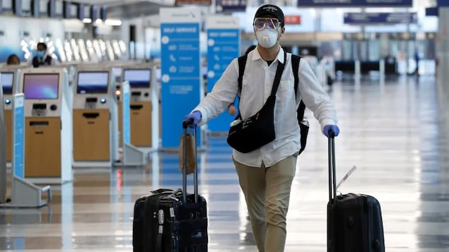 Traveller arriving at Trudeau Airport. By July, vaccinated travellers entering Canada will be able to skip the 14-day quarantine requirement.