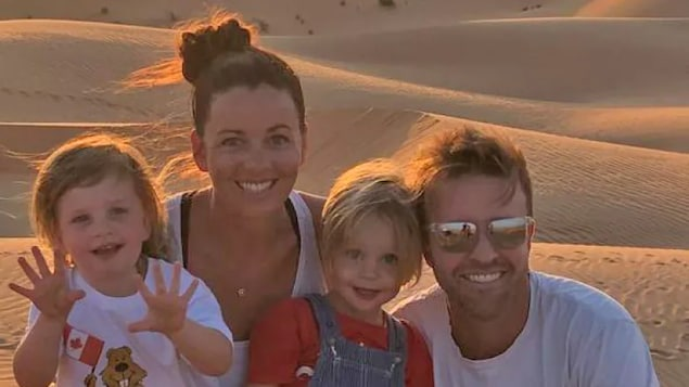 Calgary-native Katie Gibson — pictured at the beach in Abu Dhabi with her husband Ben and three-year-old twins Nash and Brooklyn — felt it was important to take the first COVID-19 vaccine available to her in the United Arab Emirates. She was dismayed to learn Ottawa may still require her to quarantine for 14 days if she enters Canada, even if it lifts that restriction for those who have vaccines approved by Health Canada.