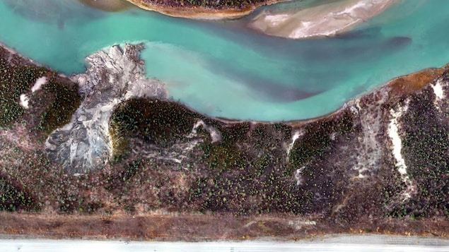 This aerial image shows the site of a permafrost slump that's caused a landslide into the Yukon River near Whitehorse.