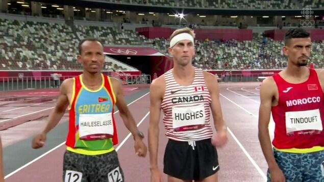 Le Canadien Matthew Hughes est à la ligne de départ et s'apprête à courir le 3 000m steeple.
