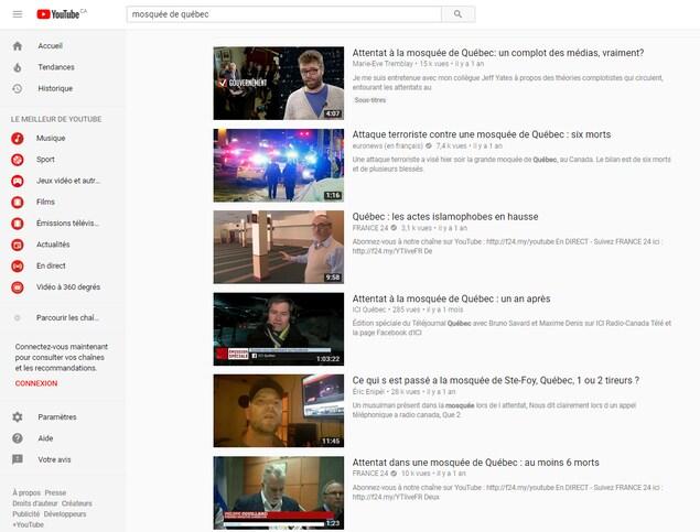 On voit les six premiers résultats de recherche, qui comprennent cinq vidéos provenant de médias d'information, et une qui provient d'une chaîne conspirationniste.