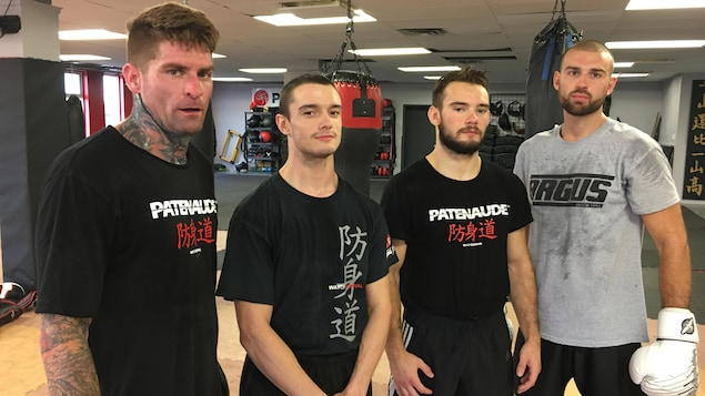Guillaume Poulin, Isaac Blais, Zackery Powell et Julien Leblanc posent pour Radio-Canada