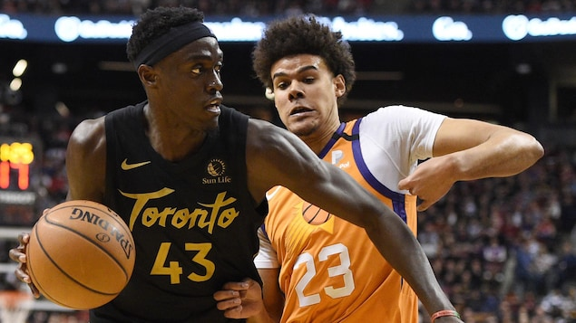 Toronto Raptors forward Pascal Siakam (43) moves around Phoenix Suns forward Cameron Johnson (23) during second half NBA basketball action in Toronto on Friday, Feb. 21, 2020. THE CANADIAN PRESS/Frank Gunn
