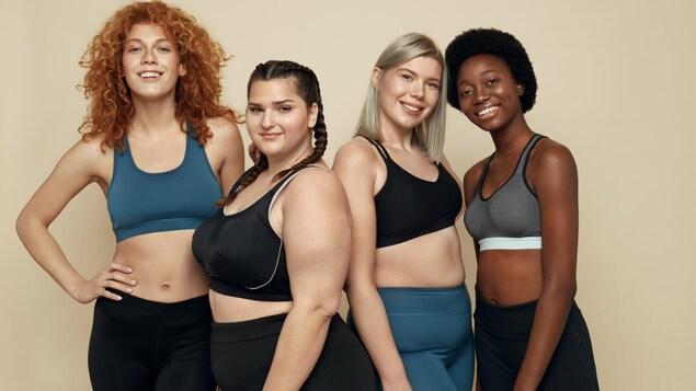 Quatre femmes de différentes tailles en tenue de sport.