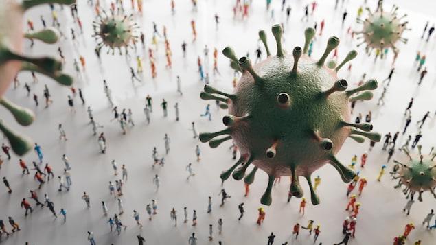 Des coronavirus en suspension au-dessus d'une foule.