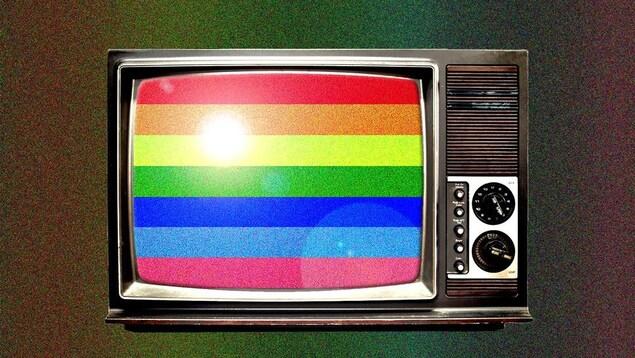 Un vieux téléviseur avec un arc-en-ciel dans l'écran.