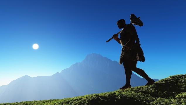 Un homme préhistorique marche dans une montagne.