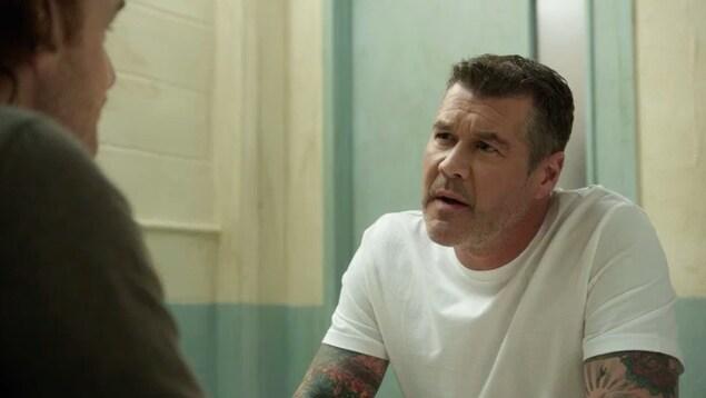 Le personnage de District 31 en prison.
