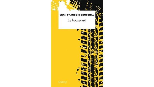 Photo de la couverture : un immeuble noir et jaune