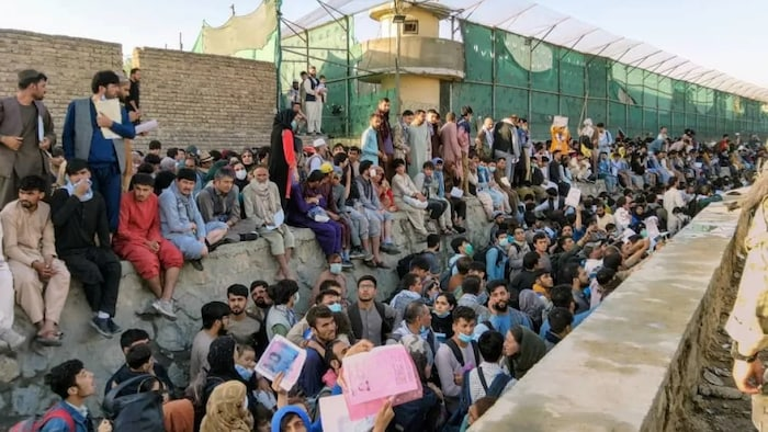 Crowds of people wait outside the airport in Kabul, Afghanistan, on Aug. 25, in this picture obtained from social media.