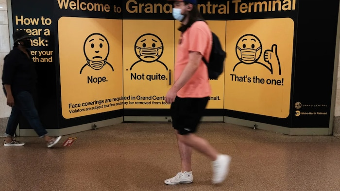 People wear masks while walking in Grand Central Terminal in New York City on July 27. Due to the rapidly spreading delta variant, the U.S. Centers for Disease Control and Prevention now recommends that fully vaccinated people begin wearing masks indoors again in places with high COVID-19 transmission rates.