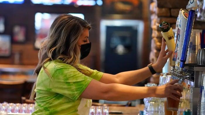 Bar women filling beer