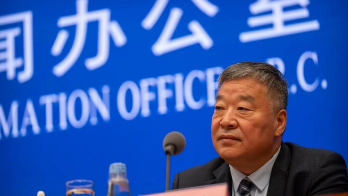 Liang Wannian, the Chinese co-leader of the joint China-WHO investigation into the origins of the COVID-19 pandemic, speaks at a news conference in Beijing on Thursday. Chinese officials dismiss the theory that the virus might have leaked from a Chinese lab.