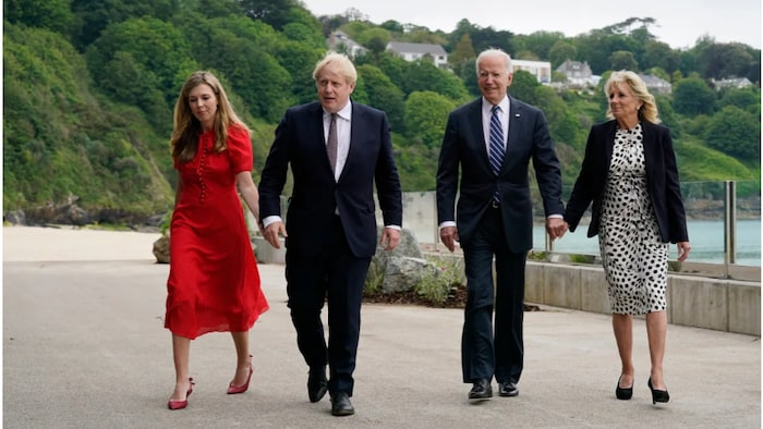 President Joe Biden and first lady Jill Biden are greeted and walk with British Prime Minister Boris Johnson and his wife Carrie Johnson ahead of the G7 summit Thursday, June 10, 2021, in Carbis Bay, England.