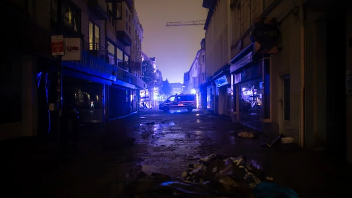 A police car stands in the city centre of Kircheim, Germany on Friday to prevent looting.