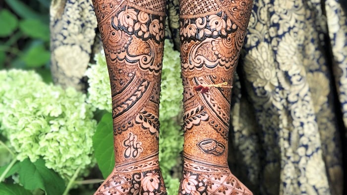 Some of Sinthusha's henna art. The henna plant is dried and turned into a paste, which is then applied to the skin.