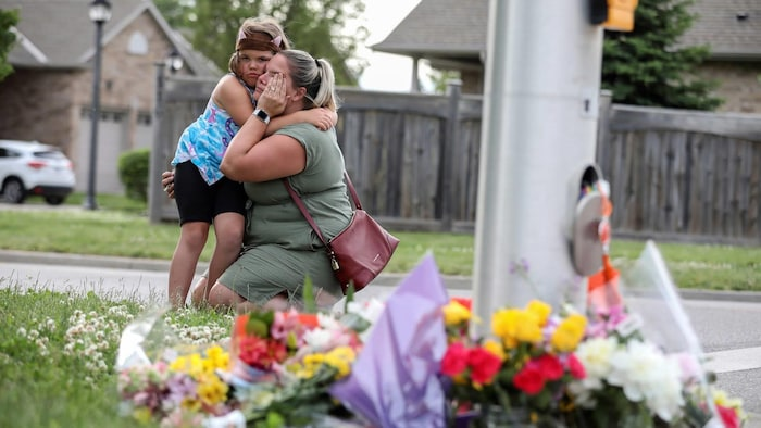 Misty Santerre and her daughter Jasmina were among mourners showing their grief over the fatal attack.