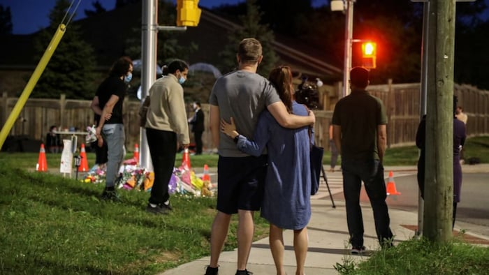 People paying respect to the victims.