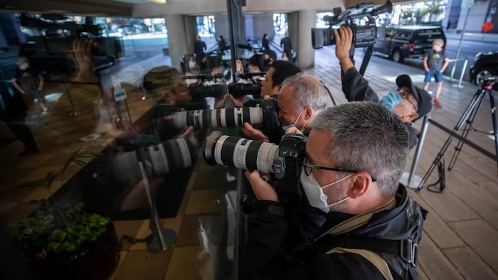 News photographers greet Huawei chief financial officer Meng Wanzhou as she arrives at court in September 2020. Her extradition case has garnered worldwide attention.